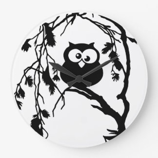 Funny owl sitting in the tree and has the moon wall clocks