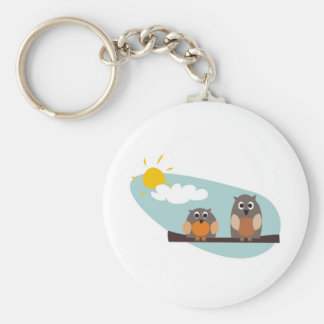 Funny owls on branch on sunny day illustration keychain