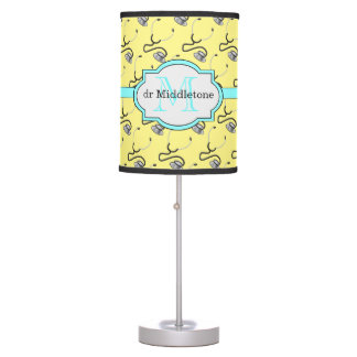 Funny stethoscopes for doctors on yellow name table lamp