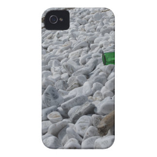 Garbage on the beach .Particular of a green bottle Case-Mate iPhone 4 Cases