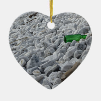 Garbage on the beach .Particular of a green bottle Ceramic Heart Ornament