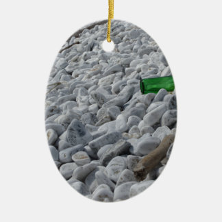 Garbage on the beach .Particular of a green bottle Ceramic Oval Ornament