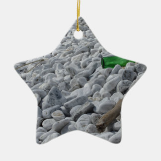Garbage on the beach .Particular of a green bottle Ceramic Star Ornament