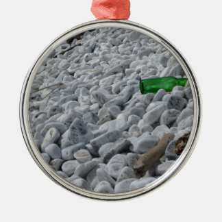 Garbage on the beach .Particular of a green bottle Silver-Colored Round Ornament