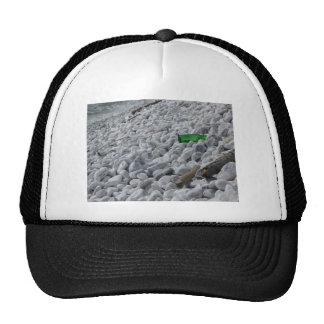 Garbage on the beach .Particular of a green bottle Trucker Hat