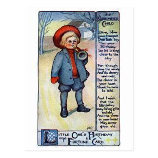 Garçon d'anniversaire de novembre avec le klaxon cartes postales