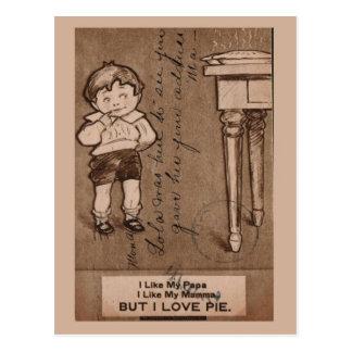 Garçon vintage de reproduction mangeant le tarte, carte postale
