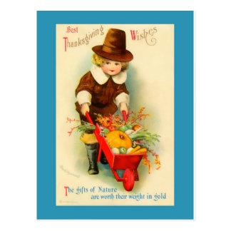 Garçon vintage et brouette de pèlerin de carte postale