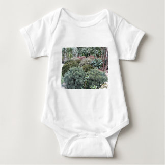 Garden centre with selection of nursery plants baby bodysuit