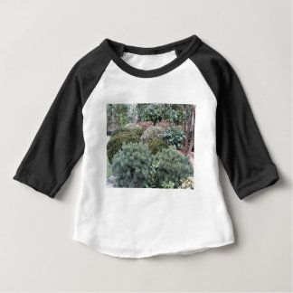 Garden centre with selection of nursery plants baby T-Shirt