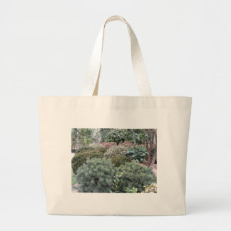 Garden centre with selection of nursery plants large tote bag