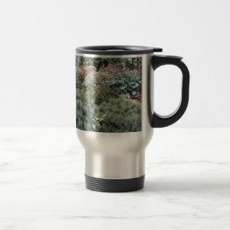 Garden centre with selection of nursery plants travel mug