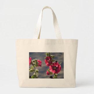 Garden Hollyhocks in a mountain valley Large Tote Bag