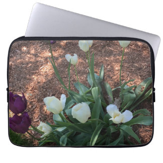 Garden of snow white tulip flowers laptop sleeve