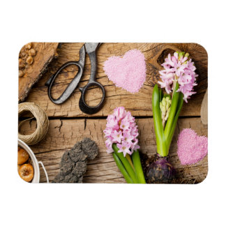 Gardening Background with Flower and Bulbs on Wood Magnet