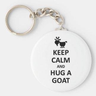 Gardez le calme et étreignez une chèvre porte-clé rond