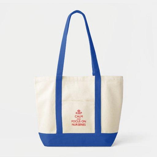 Gardez le calme et le foyer sur des crèches sac en toile