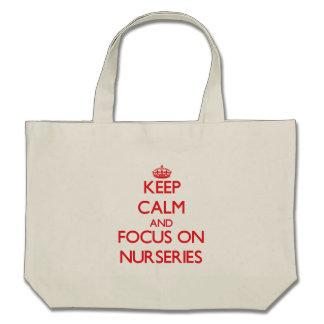 Gardez le calme et le foyer sur des crèches sacs fourre-tout