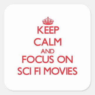 Gardez le calme et le foyer sur des films de la autocollants carrés