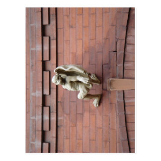 Gargoyle Hanging on  Red Brick Wall Postcard