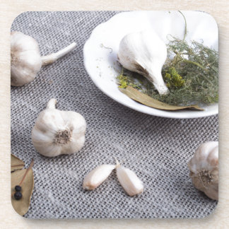Garlic and spices on a gray fabric background drink coasters