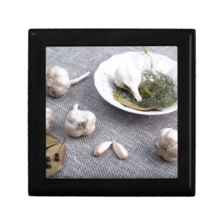 Garlic and spices on a gray fabric background gift box