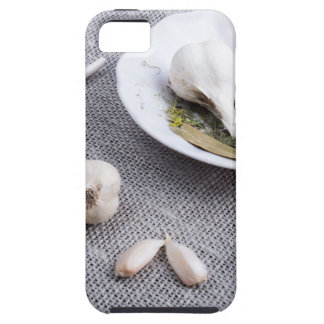Garlic and spices on a gray fabric background iPhone 5 cases