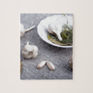 Garlic and spices on a gray fabric background jigsaw puzzle