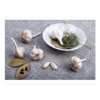 Garlic and spices on a gray fabric background postcard