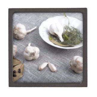 Garlic and spices on a gray fabric background premium trinket box