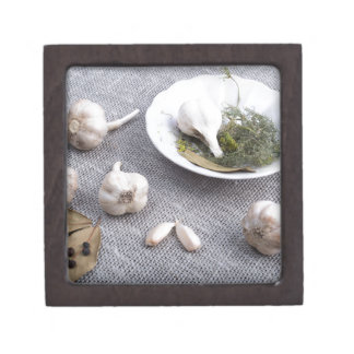 Garlic and spices on a gray fabric background premium trinket boxes