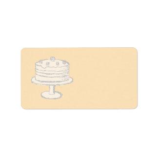 Gâteau crème de couleur sur le fond beige étiquette d'adresse