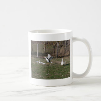 Geese fighting coffee mug
