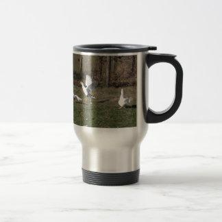 Geese fighting travel mug