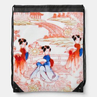 Geishas in garden backpack