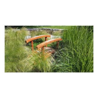 GENTLE FLOWING GRASS AMONGST A BRIDGE CANVAS PHOTO PRINT