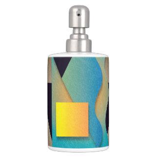 Geometrics on textured bronze, yellow/orange soap dispenser and toothbrush holder