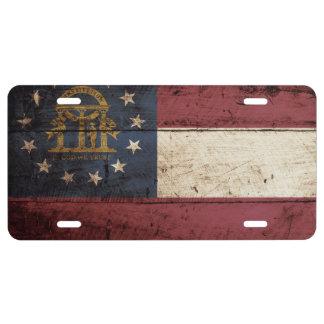 Georgia State Flag on Old Wood Grain License Plate