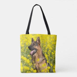 German Shepherd(s) in field of yellow flowers tote