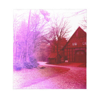 german wooden town house in forest red tint notepad