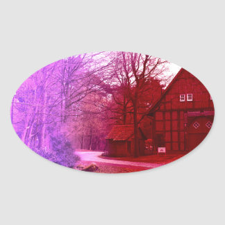 german wooden town house in forest red tint oval sticker