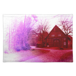 german wooden town house in forest red tint placemat