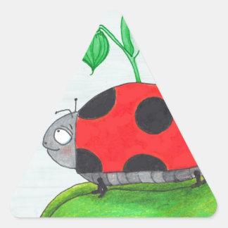 Giant red ladybug on a leaf triangle sticker