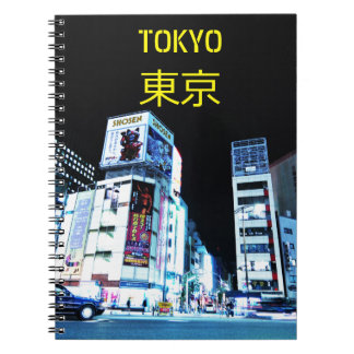 Ginza district in Tokyo, Japan at night Spiral Notebook