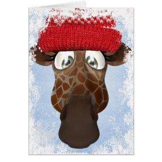 Girafe mignonne dans la carte de Noël de chapeau d