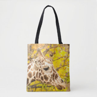 Giraffe and leaves tote bag
