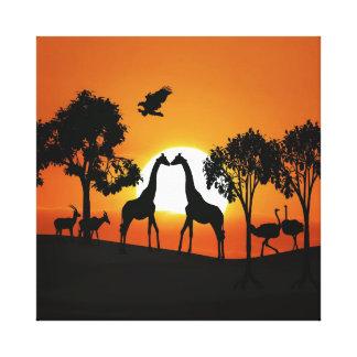 Giraffe at sunset canvas prints