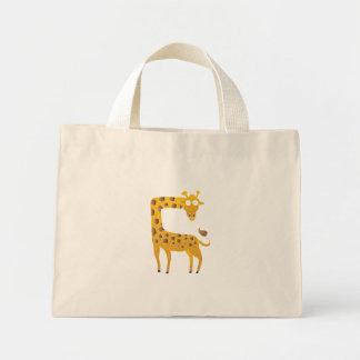 giraffe cartoon. mini tote bag