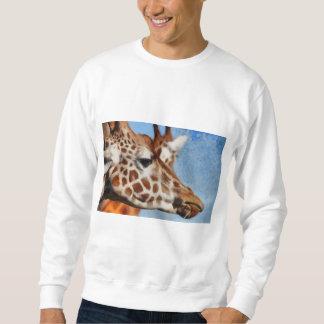 Giraffe eating its food sweatshirt