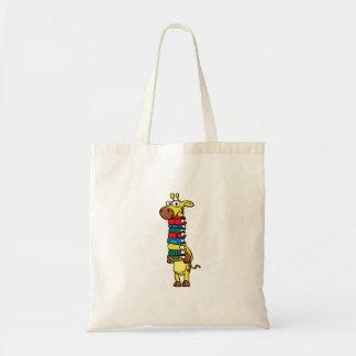 Giraffe holding books tote bag